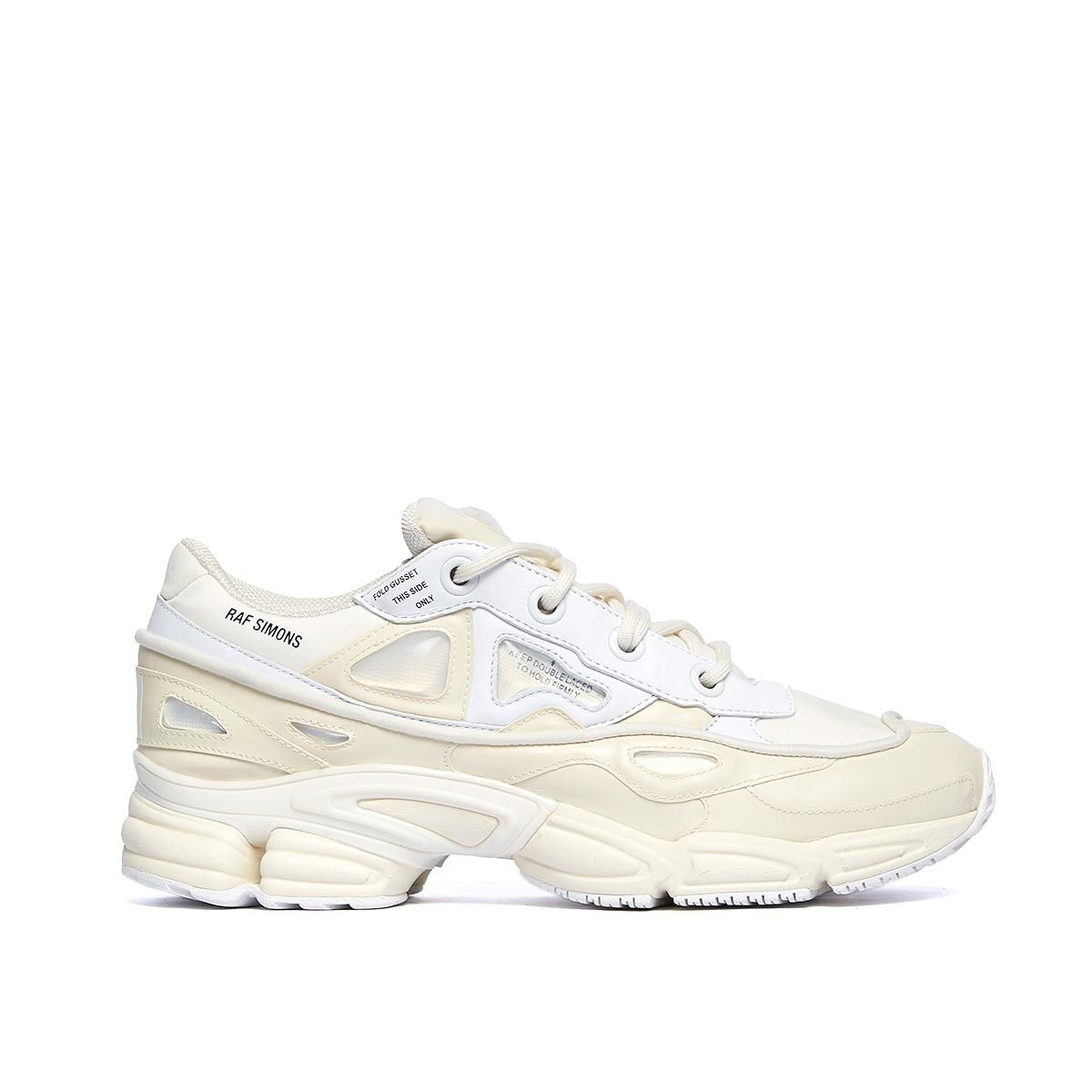 Delivery by March 31 Ozweego Bunny sneakers from the S/S2017 Raf Simons x Adidas collection in cream white These sneakers are from Raf Simons new collection in collaboration with Adidas. The sneaker, here in cream white, takes a futuristic approach in a two layer upper with a running inspired profile and details made of silicone. The Oswego Bunny sneakers rubber, mesh and leather upper, mesh lining, EVA midsole and rubber outsole. - Cream white sneakers - Rubber, mesh and leather upper -...