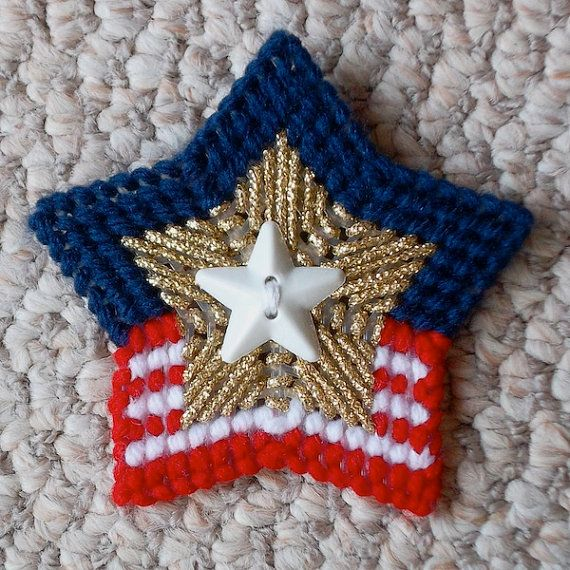 This listing is for 2 shiny star magnets. Sewn in cherry red, white and soft navy yarns, each magnet is sewn with gold cord accents around a large plastic star button. They will make a cheerful addition to your Fourth of July picnic, or hold that all-important cookout shopping list for the family reunion. Also, consider giving this gift as a thank you to a veteran in your life.    This magnet set looks very different visually as you spin the stripes to different positions. Please see the…