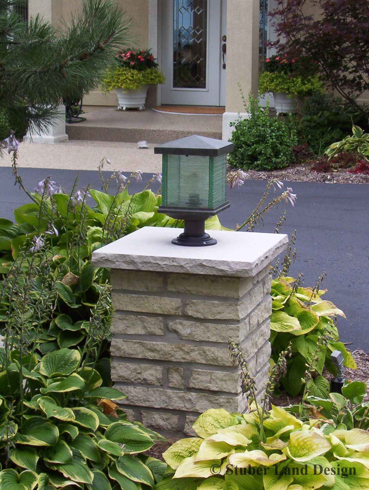 Mortared stone pillar with landscape lighting columns for Driveway landscape lighting