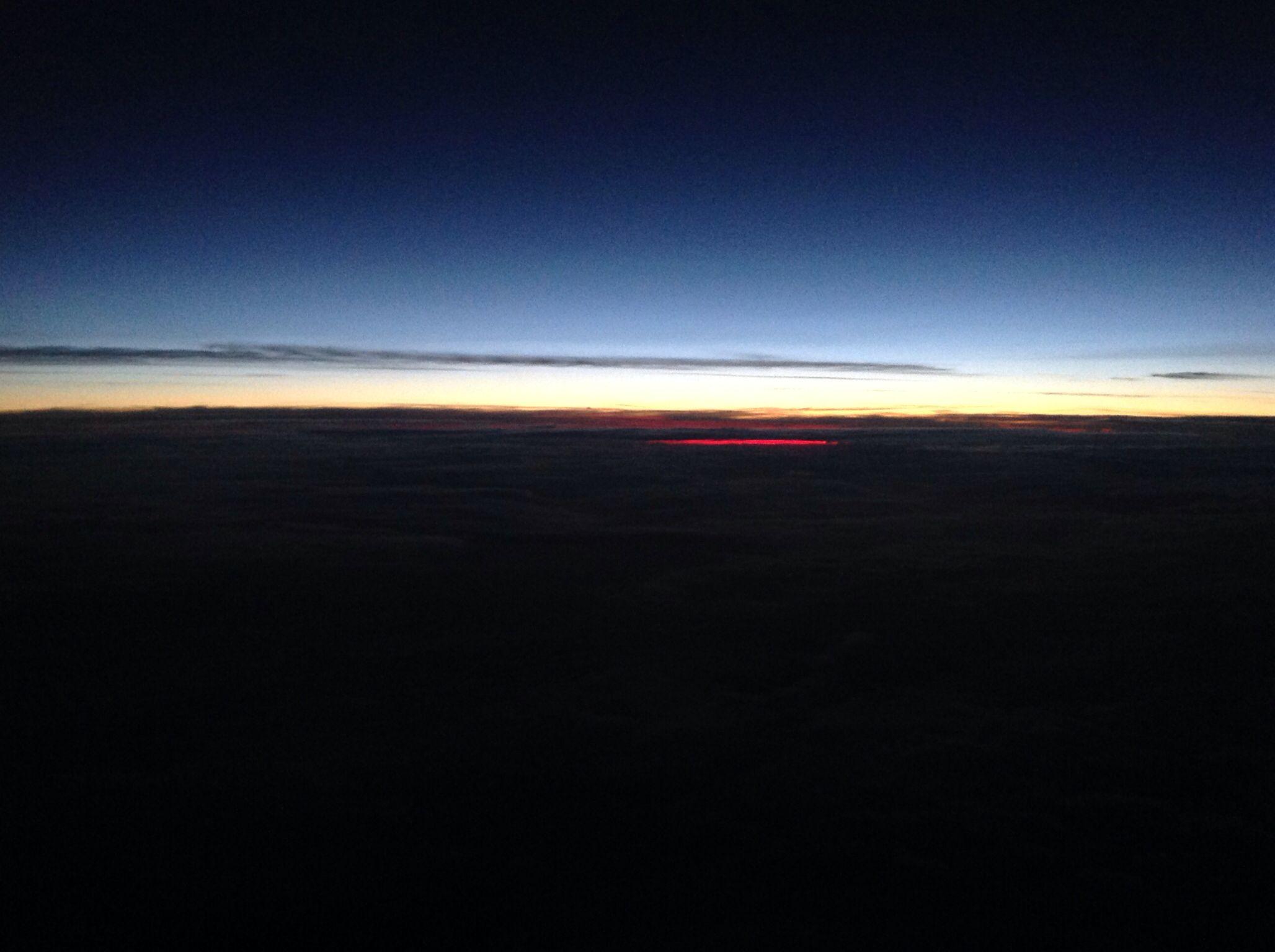 The sun setting at 30,000 feet.