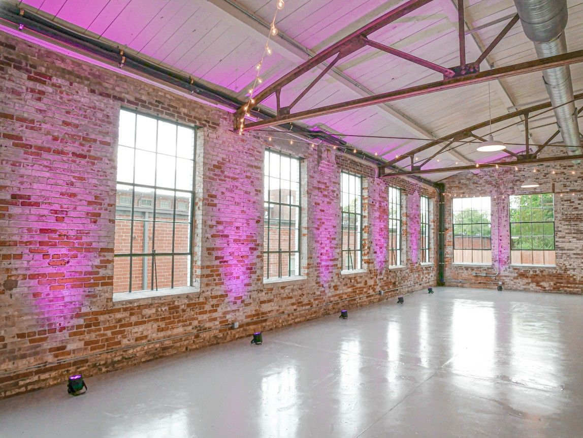 Our uplighting package highlighting the beauty of The Graham Mill, a brand new venue in Graham, NC