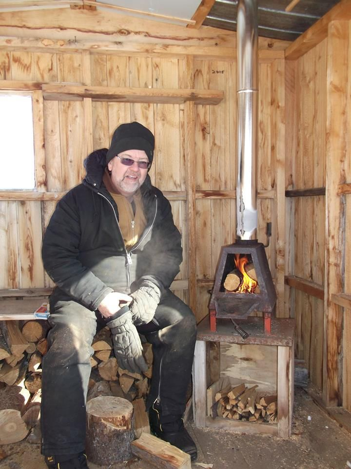 Tiny woodstove in ice fishing shack  Near Kapuskasing, ON