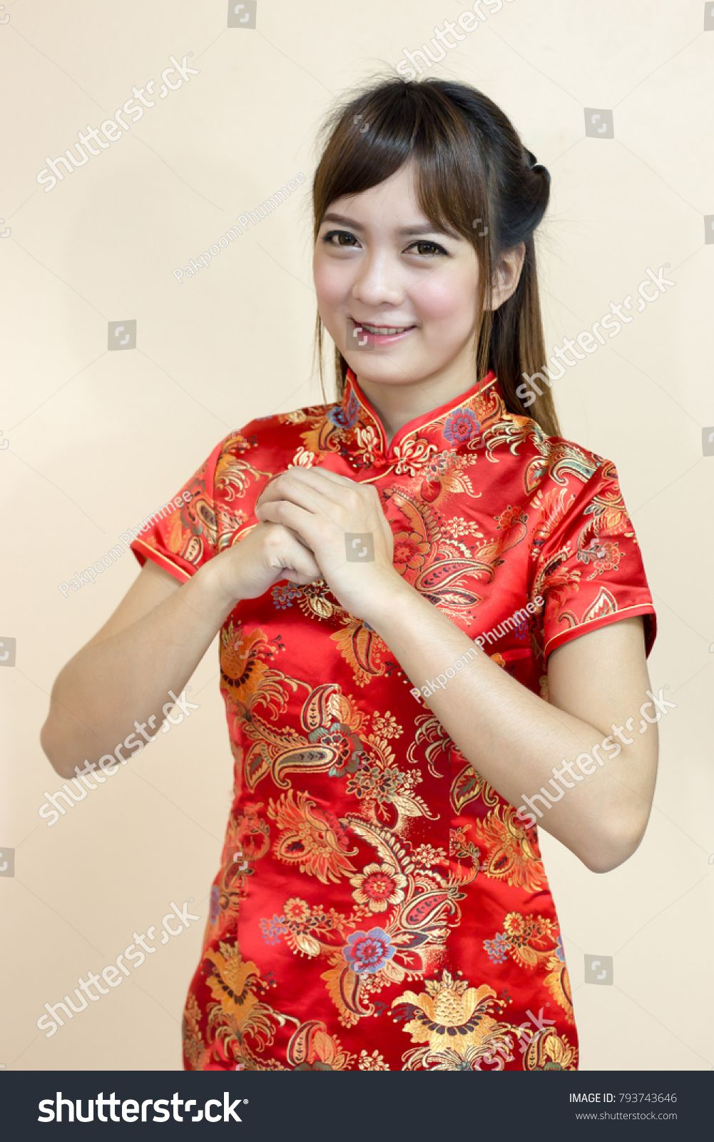Asian woman greeting in traditional chinese or cheongsam with hand asian woman greeting in traditional chinese or cheongsam with hand lift welcome expression and lucky in m4hsunfo