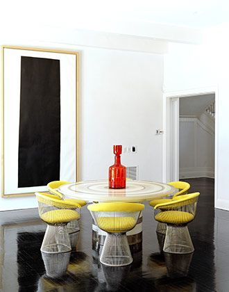 This minimalist dinning room features Knoll's 'Platner Arm Chair' in yellow. Available at the D&D Building suite 1523 #ddbny #knoll