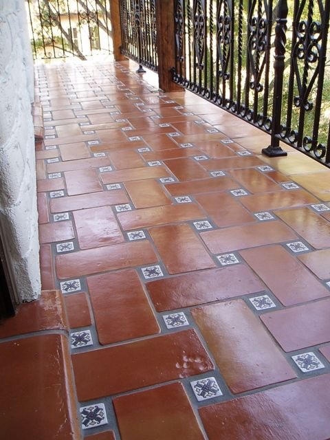 6x12 Super Saltillo tile with 2x2 Talavera decorative tiles as inserts on a patio. I love this for an outdoor patio or courtyard!