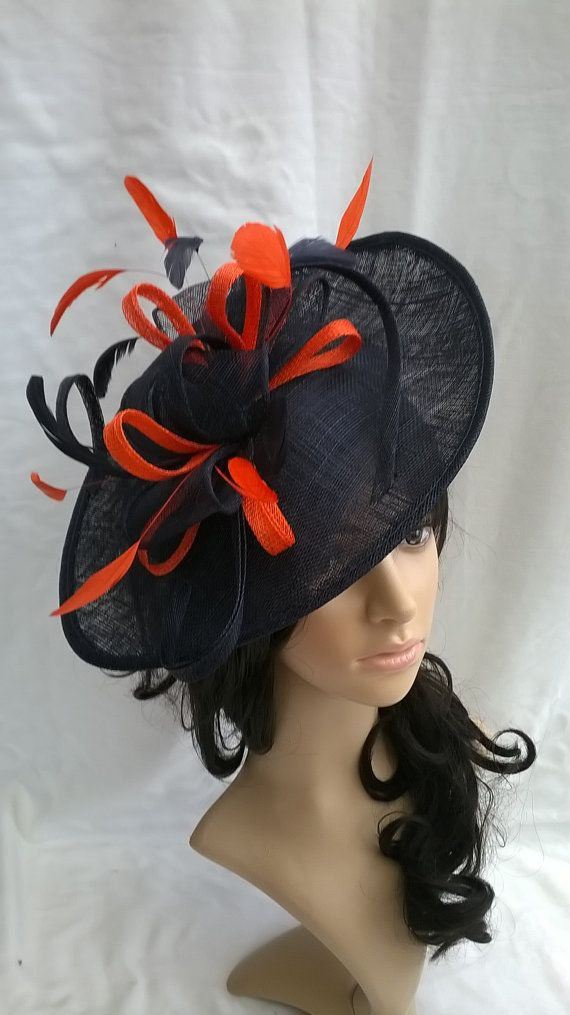 Navy Fascinator Hat With Orange Trim Feathers On A Headband