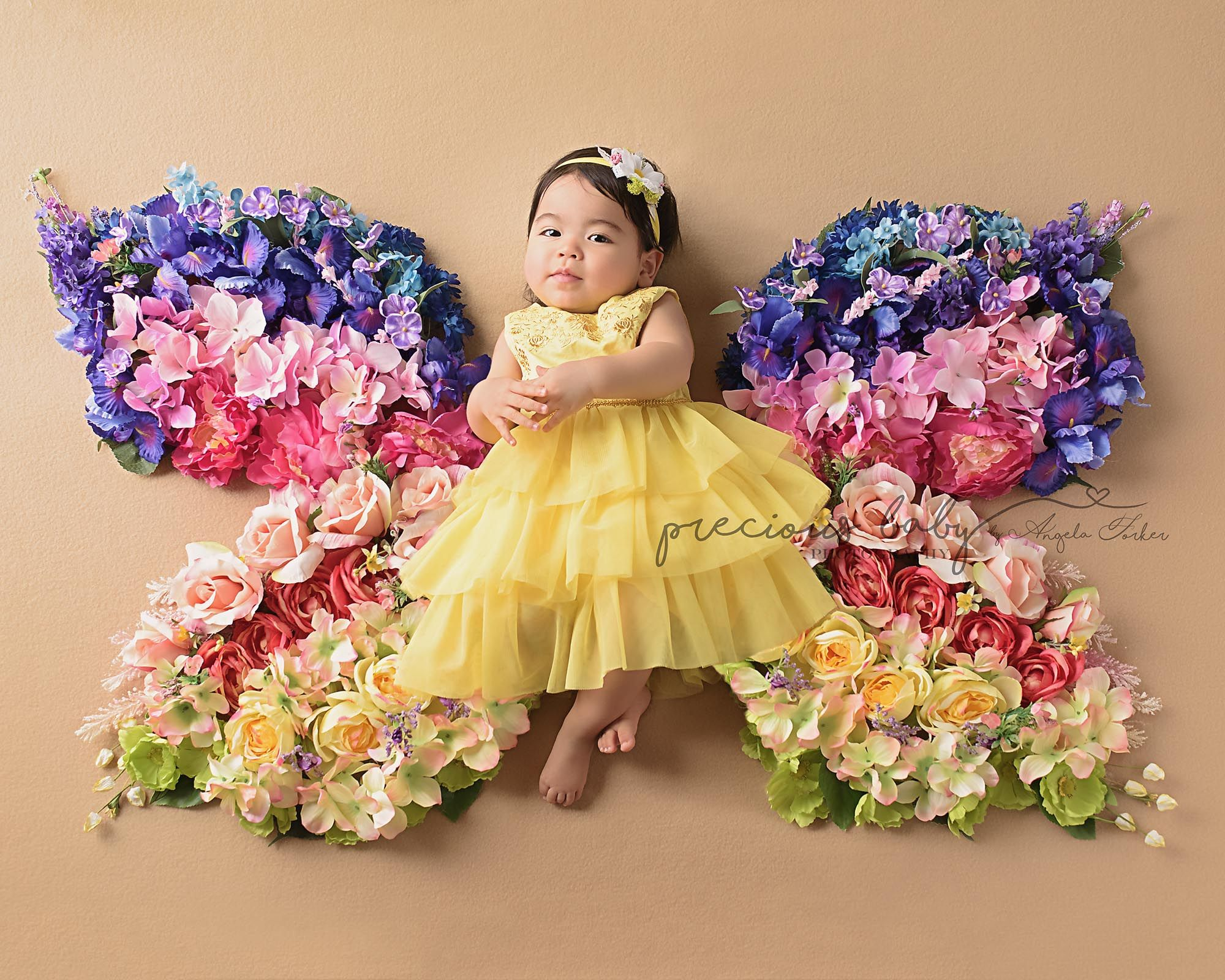 Beautiful Hispanic Baby Girl Lying On A Butterfly Flower Blanket Multicolored Rainbow Colors Roses Baby Photoshoot Baby Photoshoot Girl Baby Girl Photography