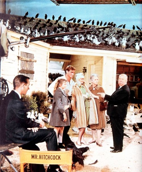 Alfred Hitchcock and his cast on the set of The Birds (1963).