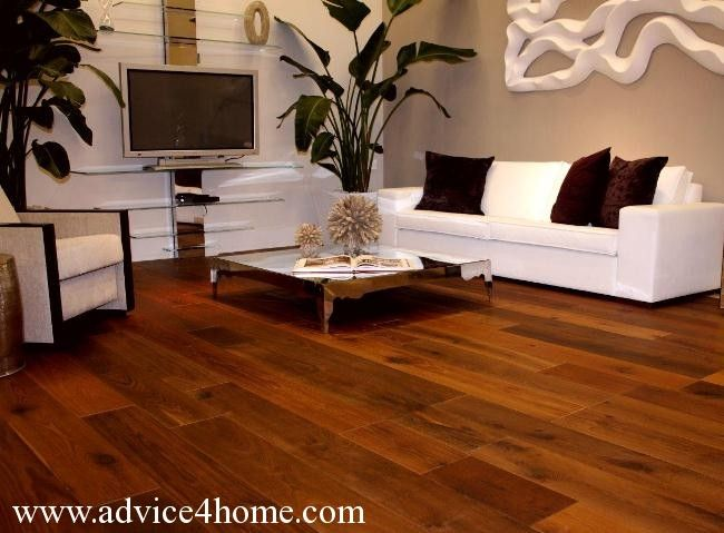 Brown yellow hardwood flooring and white sofa design and wall design in living room wooden - Woodwork design for living room ...