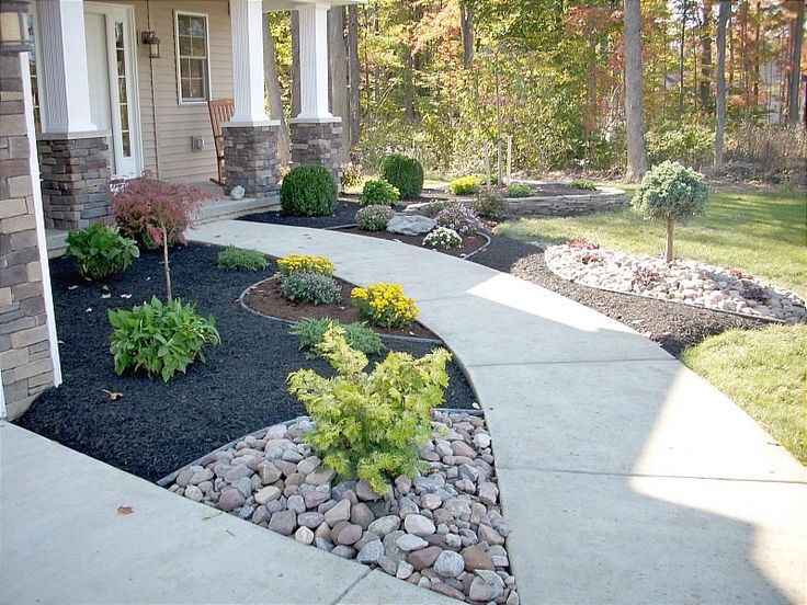 Front yard landscape with black bark Front yard
