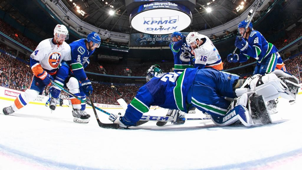 Andrew Ladd sends Islanders past Canucks in overtime  Forward scores 1:33 into extra period after Vancouver ties it with 19.3 seconds left