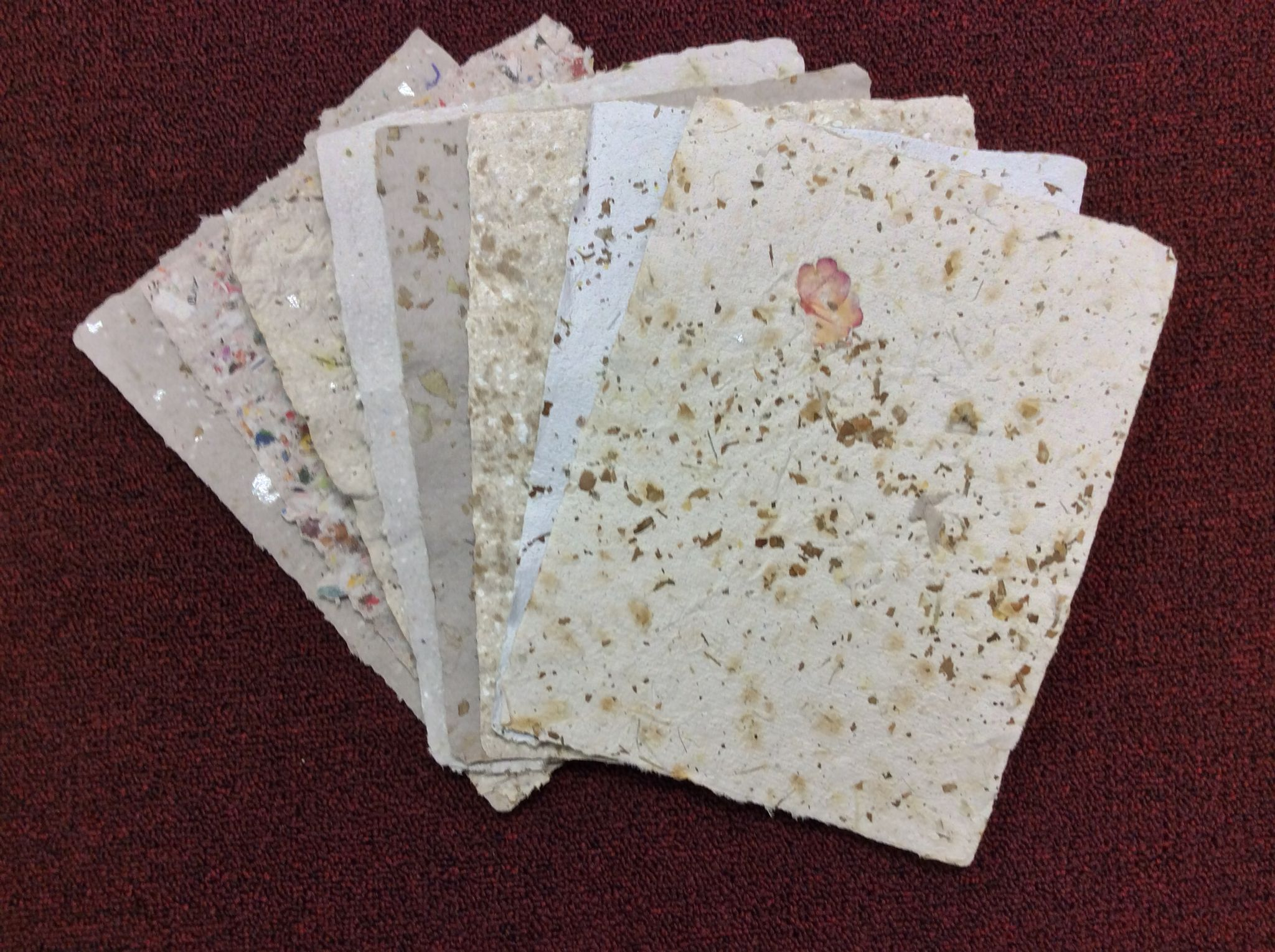 handmade paper made with recycled mail egg cartons and dryer lint