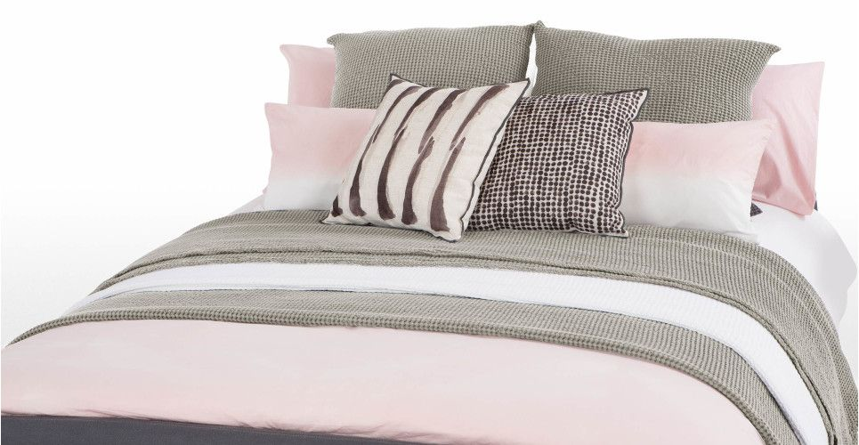 Lighter sheets and grey throw / pillows.