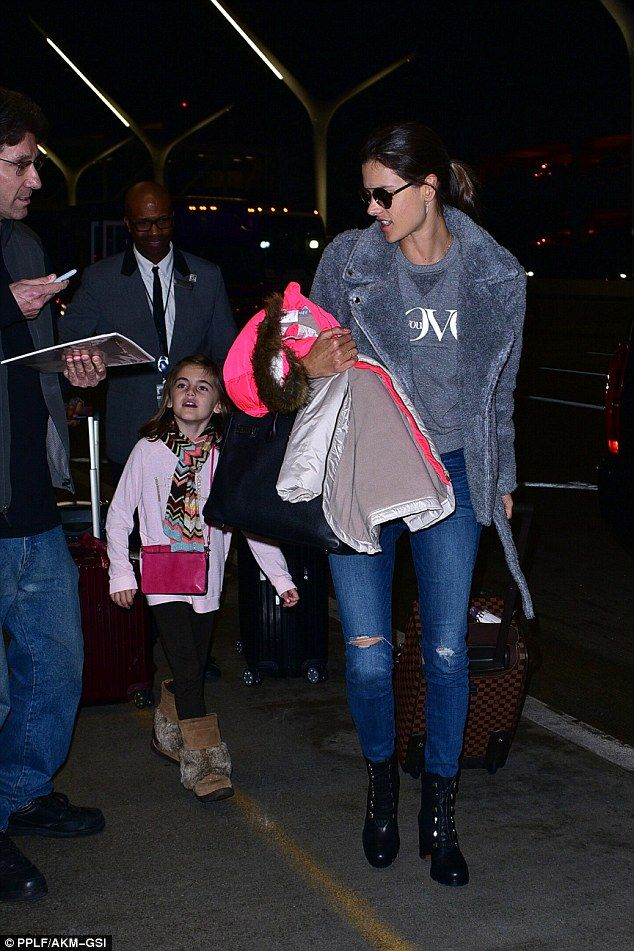 Cute: Alessandra kept a watchful eye on her little one as they made their way down the st...