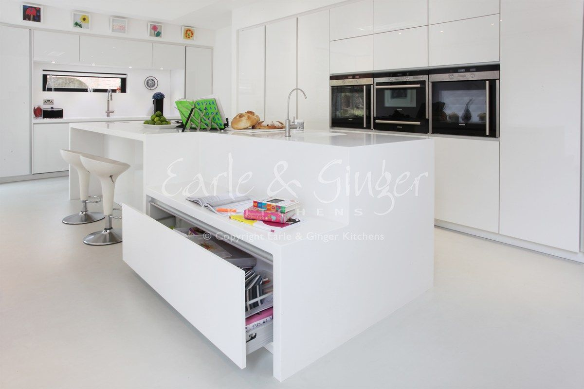 A contemporary family kitchen white high gloss designer white corian work surfaces and molded - Stylishly modern kitchen islands additional work surface ...