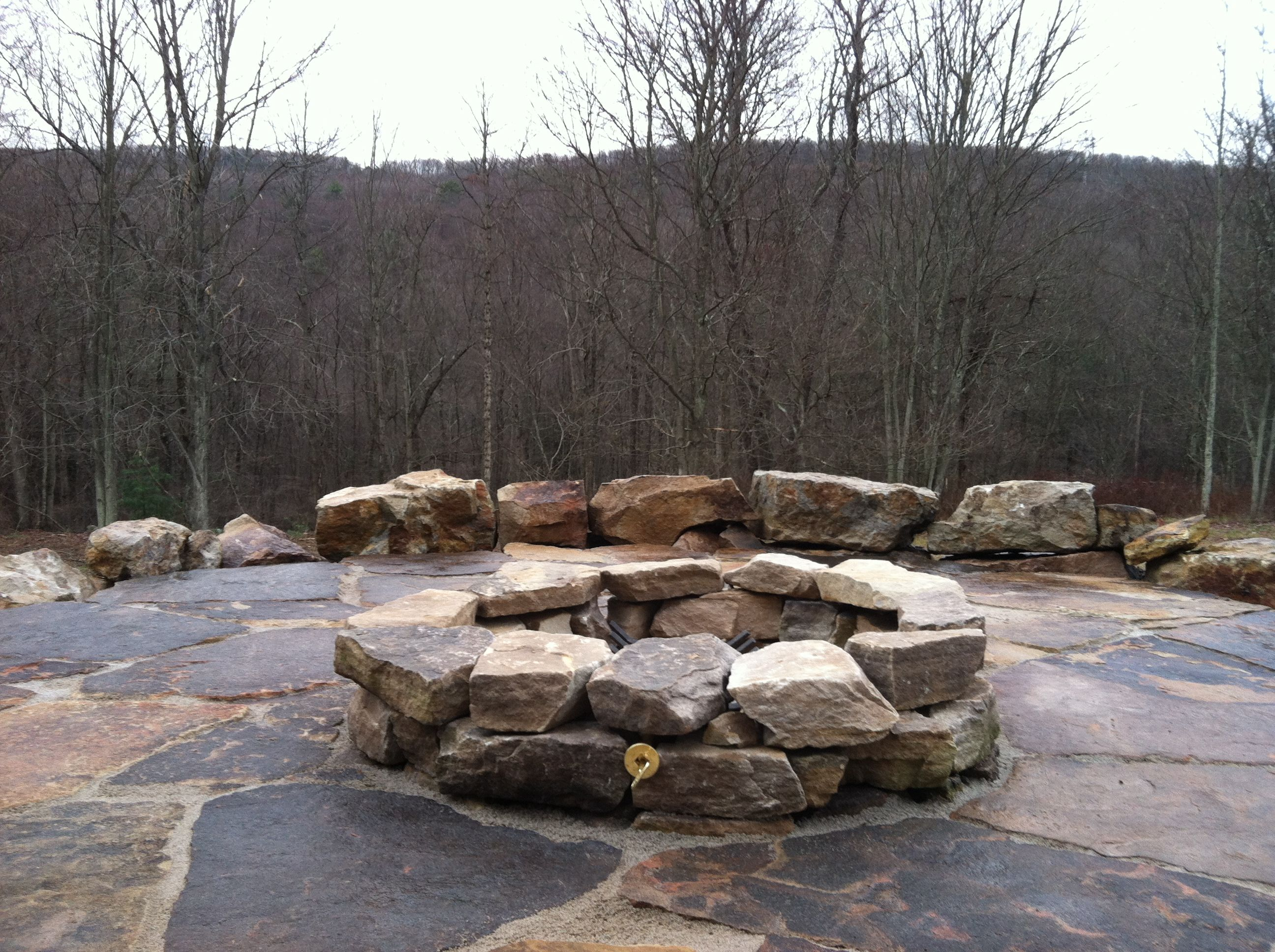 Natural boulder firepit, slate patio and boulder seat wall