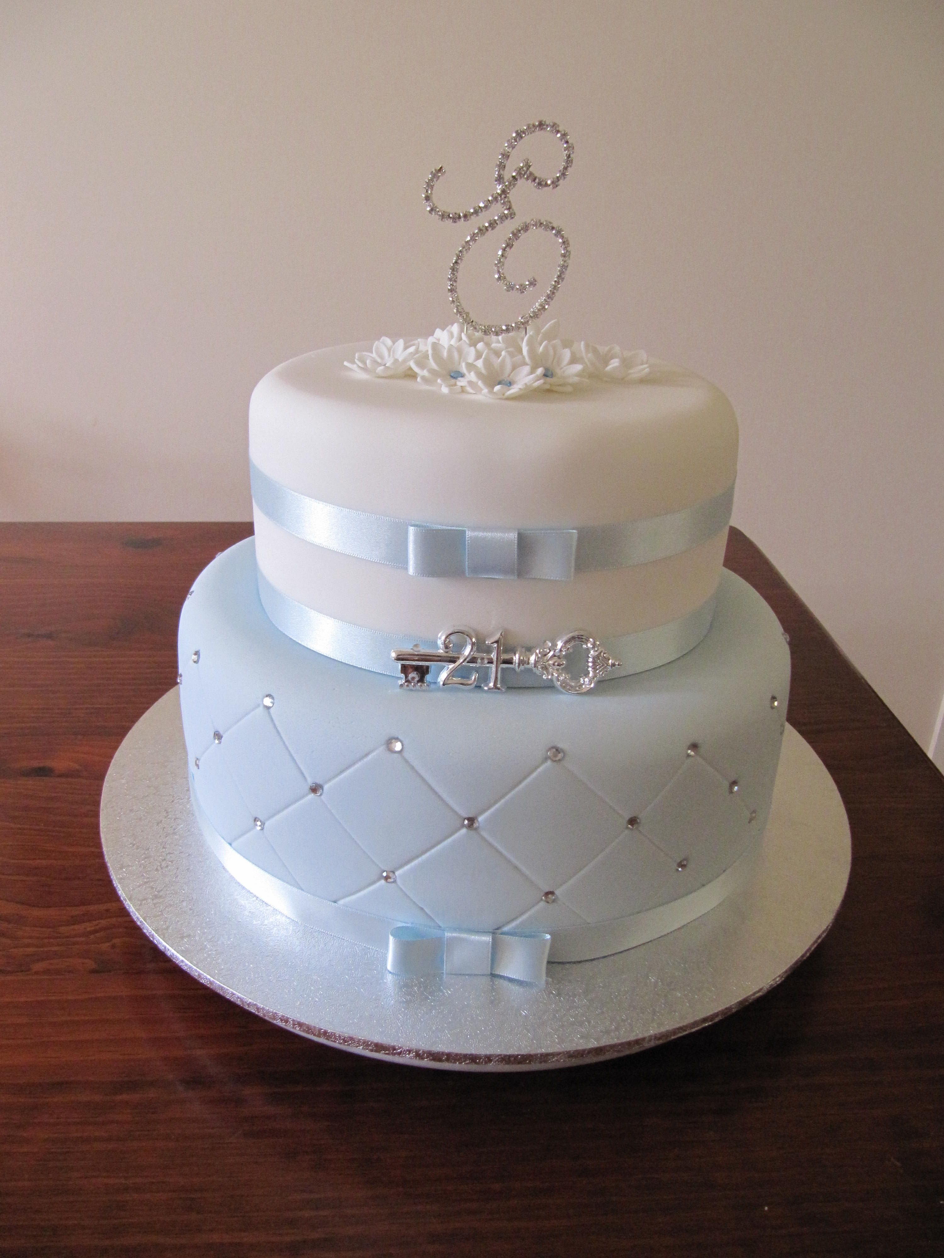 2 tier 21st Birthday cake in blue and whiteBling quilting and