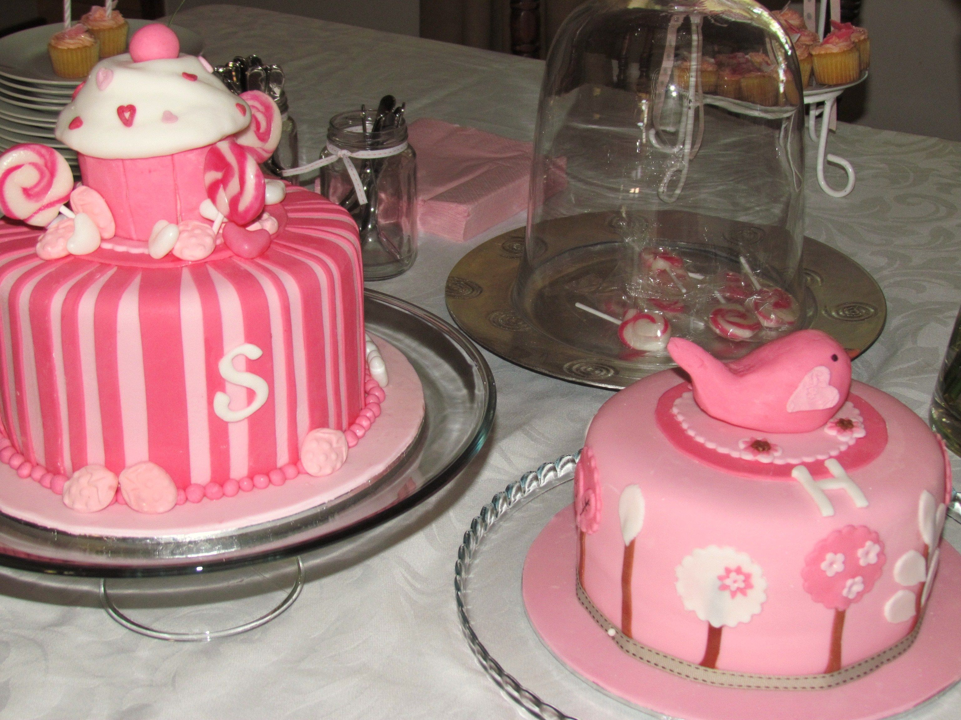 Pink and white cupcake and bird cakes for twins with a sweet shoppe