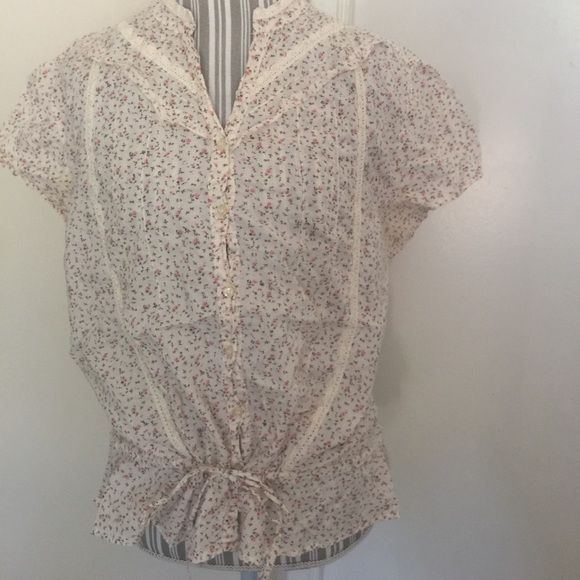 No Boundaries Rose Bud Spring Blouse Juniors XXL This blouse is very sweet and just in time for Spring. Light weight material. Size XXL in Juniors, this would fit a woman's med/large. Lace details all over and draw string at waist. So adorable! Pit to Pit laid flat 22 inches. Shoulder width 18 inches laid flat. Top of shoulder to bottom, 22 inches. Waist fully opened laid flat 22 inches. No Boundaries Tops Blouses