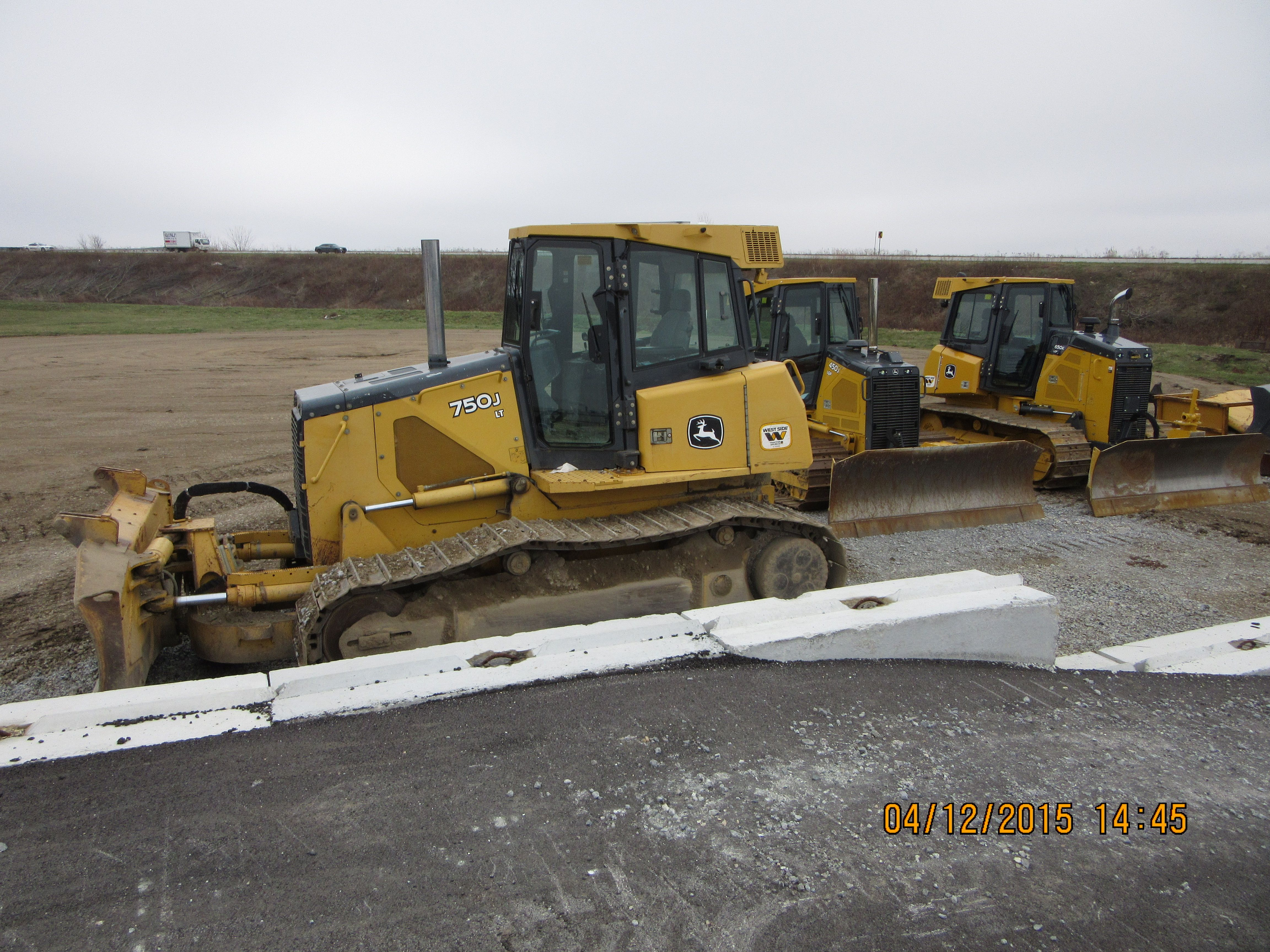 John Deere bulldozers from r-l:650K,450J,750J from loading dock