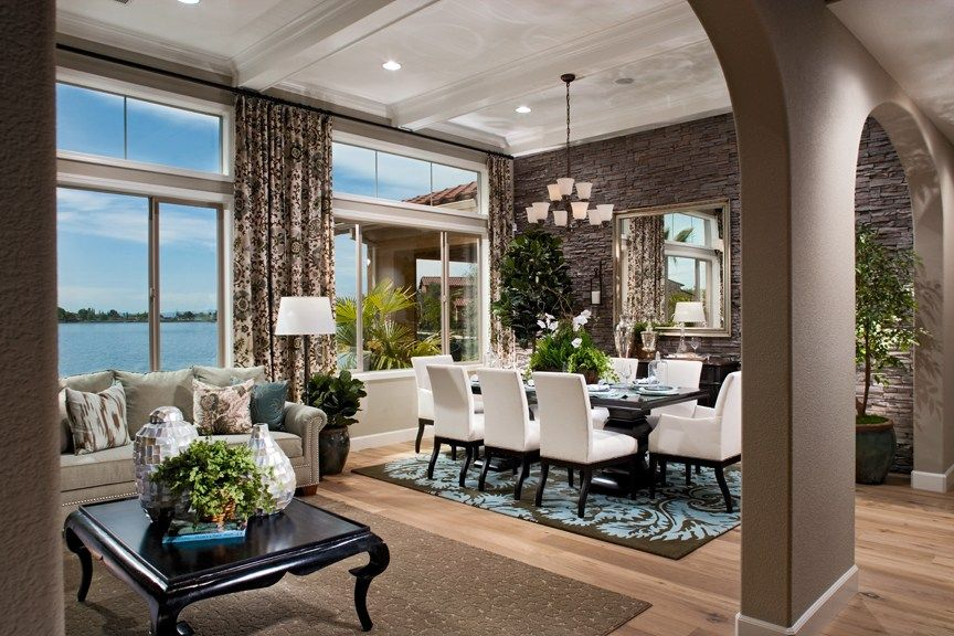 A Distinctive Stone Accent Wall Defines Dining Room In Stunning New Home Built By