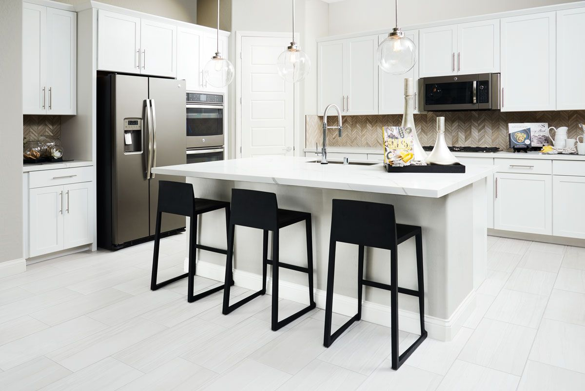 Bright White Kitchen With Contrasting Bar Seating And Appliances Anika Mod Traditional White Kitchen Cabinets American Kitchen Design Kitchen Cabinet Design