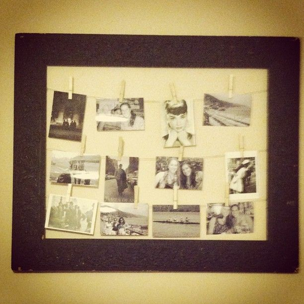 took an old frame and hot glued string then used clothes pins to hang b pictures and art