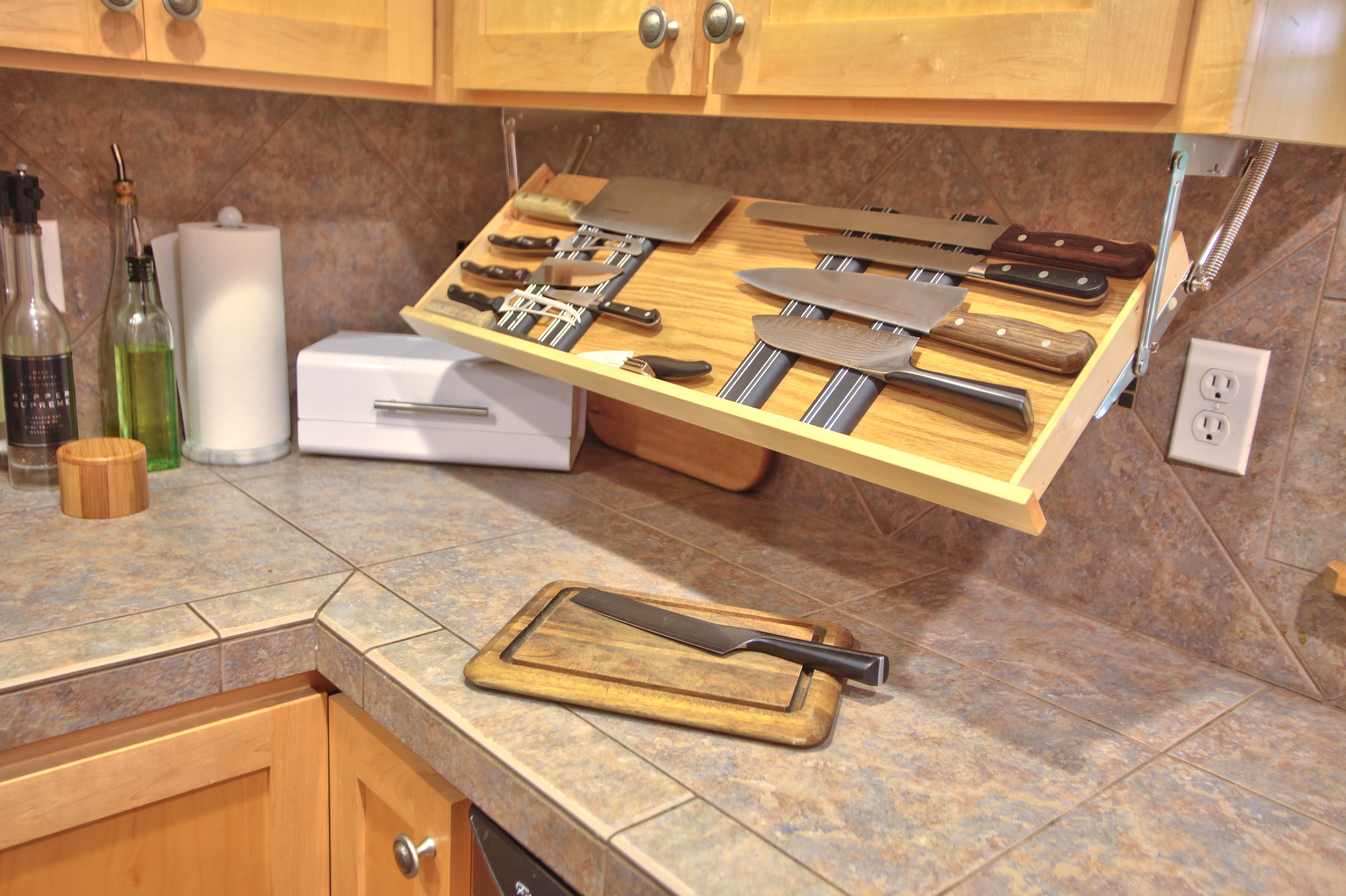 Get the knife out Under counter drop down knife storage
