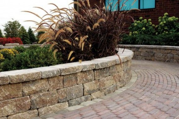 unilock wall and planter featuring unilock estate wall paver