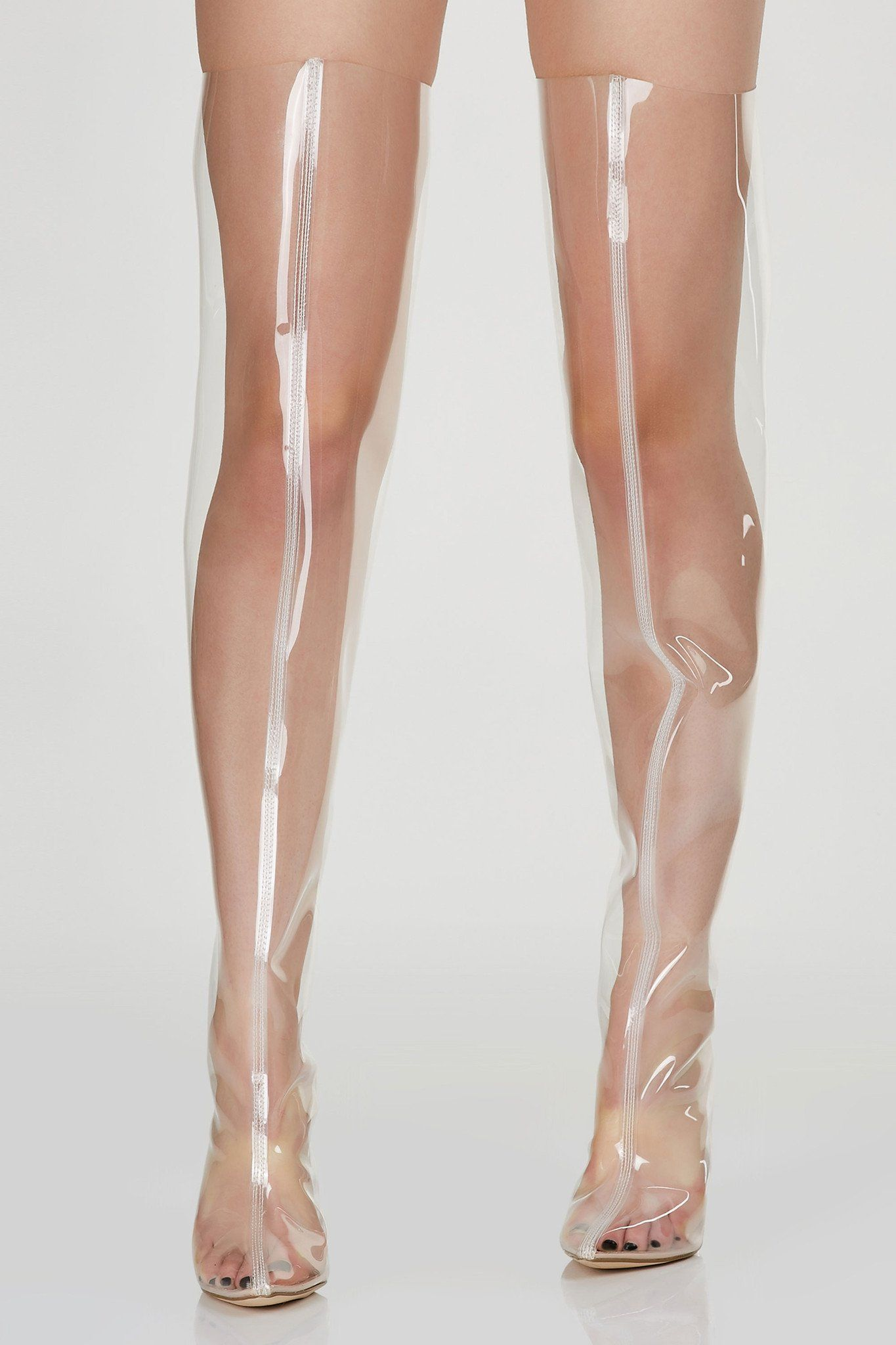 4470eb3c685 See through thigh high boots with back zip closure. Pointed toe with clear  block heels.