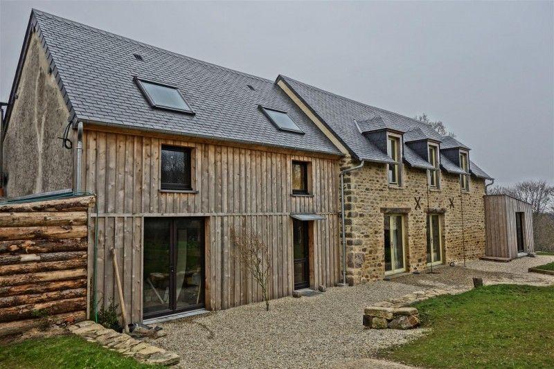 Portes et fenêtres bois laquées sur maison ossature bois et pierre