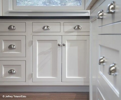 Cabinet hardware: cup pulls on the drawers is a must ...