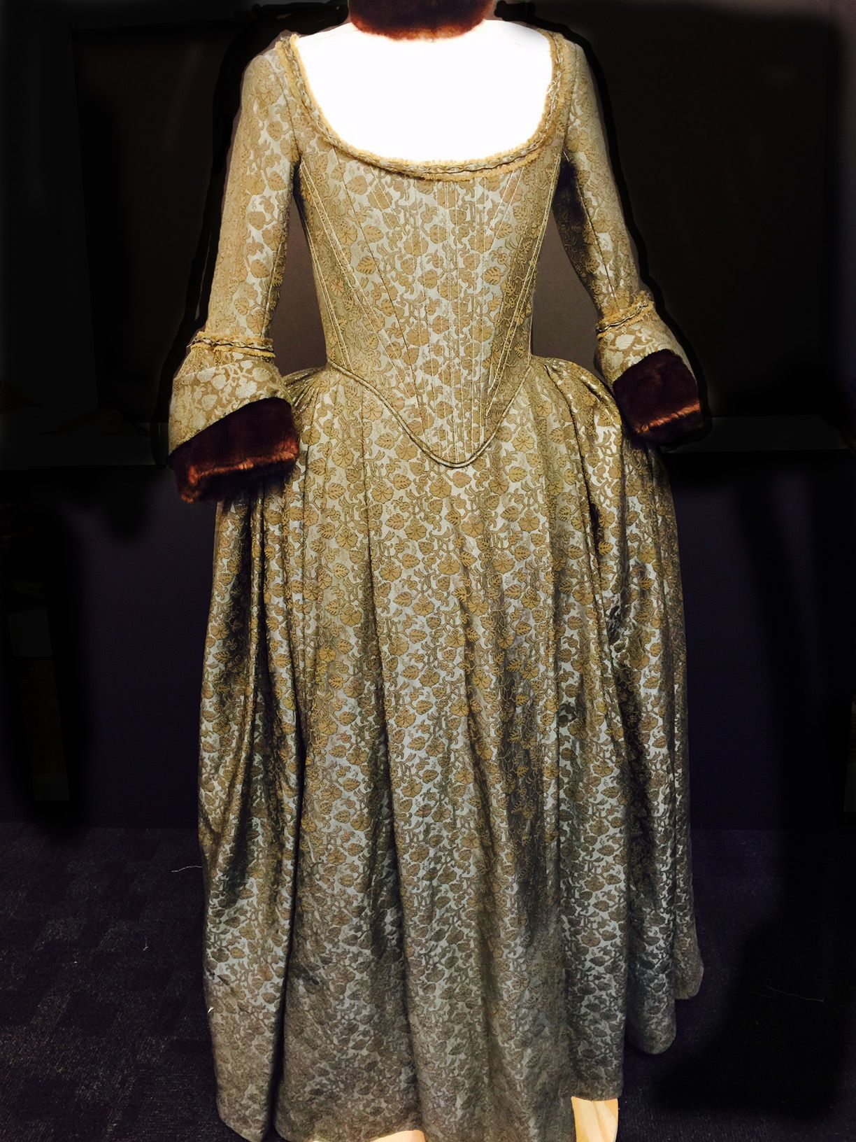 Claireus green brocade gown worn to the banquet for the duke of