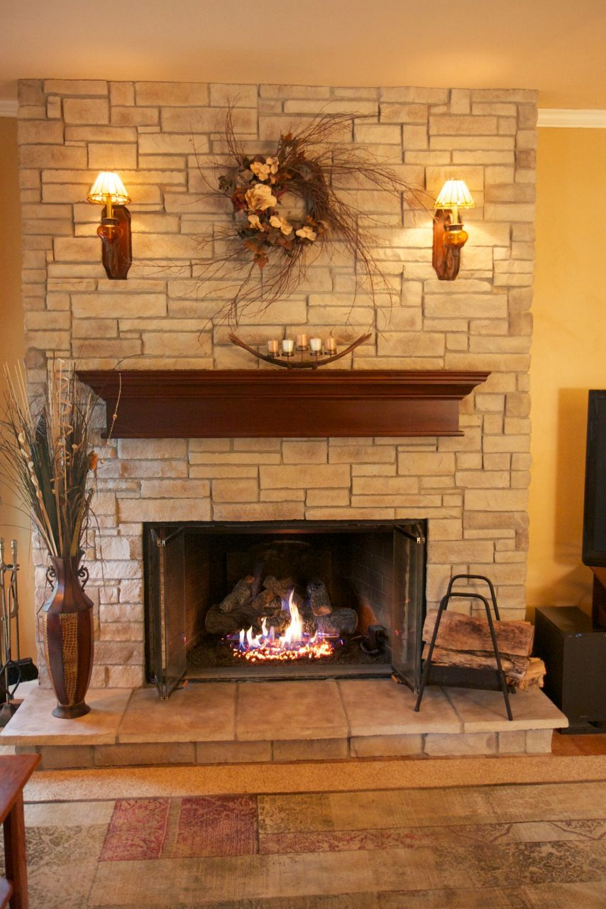 This gorgeous fireplace was transformed using a ledge - Chimeneas orus ...