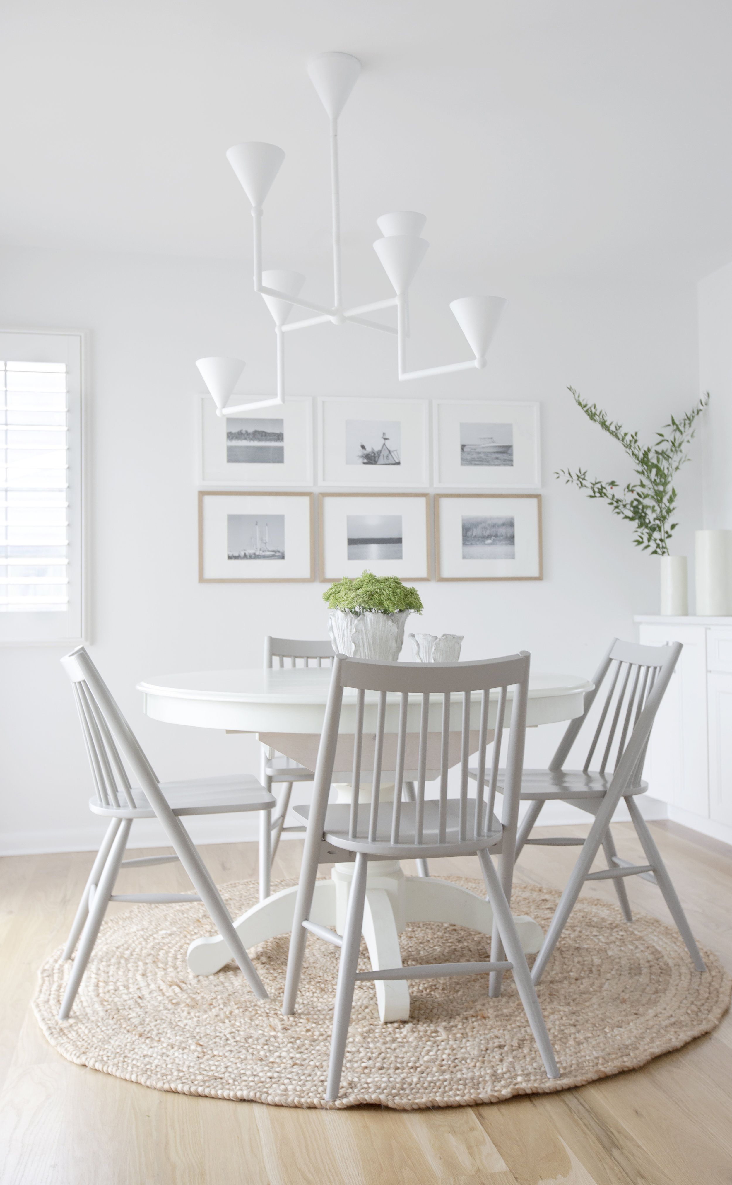 All White Dining Room With White Spindle Chairs White Modern