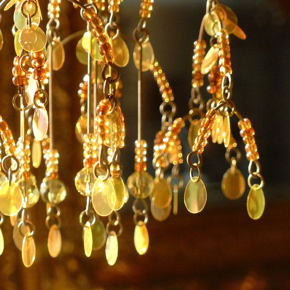 A Sequined Sunshower Chandelier by BellStudios on Etsy