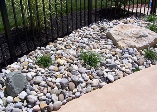 river rock planter area stone