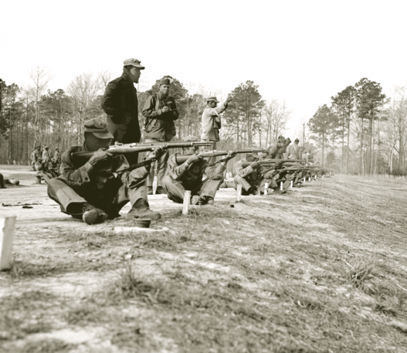 """Allowed to serve in the Corps beginning in June 1942, the African-American Marines were """"all ready on the firing line,"""" and began to fill the 51st Defense Bn, which deployed to war in January 1944."""