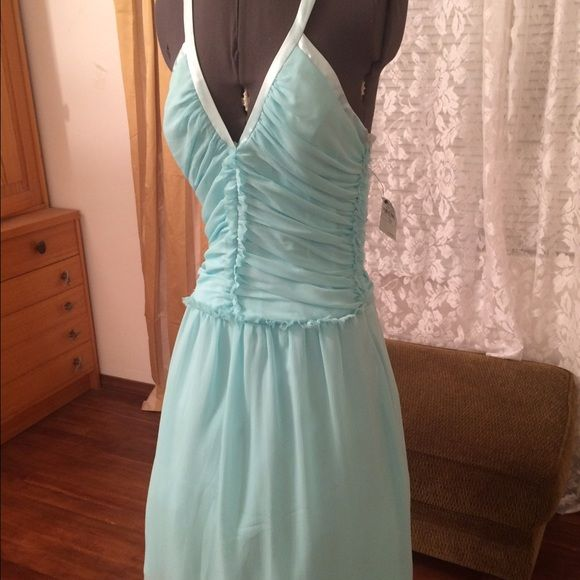 "NWT Neiman Marcus ABS Schwartz Chiffon Dress $190 New with Tags- from Neiman Marcus ABS by Allen Schwartz 2 layer Chiffon party dress-Aqua Tiffany blue size 10.  Bust 34"" Deep V Cross Back.  No returns-all sales final ABS by Allen Schwartz Dresses Mini"