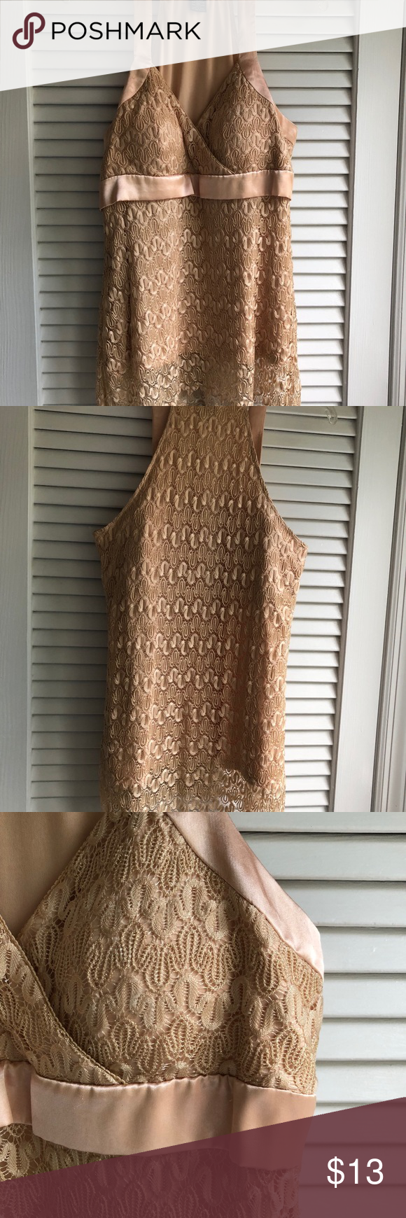 Lace with satin tan ladies top Beautiful lace and satin ladies halter top that's sure to get compliments. Very classy and elegant. New, never worn. Wear this top with a pair of jeans and pumps, or with a pair of white slacks. Runs a bit small for a L on tag, Gorgeous top.