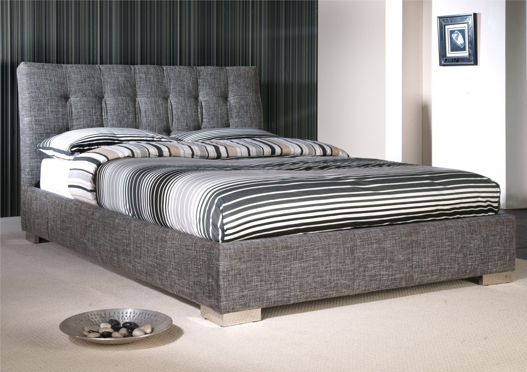 a modern bedstead in laste waffle fabric featuring a curved headboard and chrome feet sprung slatted to give extra comfort bed available in and