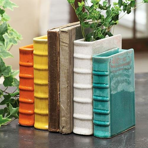 Bookend Vase: Made from terra cotta and given a colorfully glossy gaze, the Bookend Vase is both a bookend and a planter. Don't hide your favorite books anymore'keep them in topple-free sight anywhere in your home. Near a window is an excellent location for this crafty piece for two reasons: natural light is good on your eyes when reading, and it helps your beautiful plants to flourish.