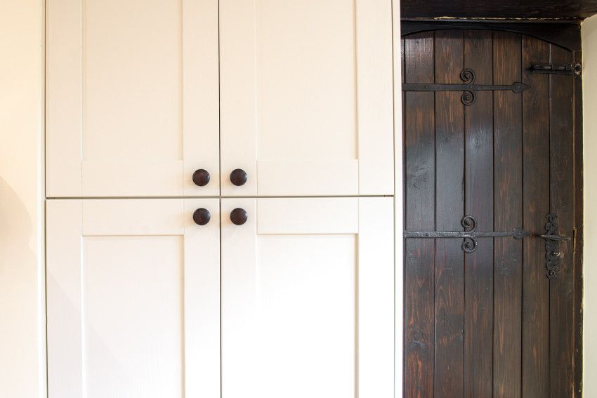 Old contrasting new kitchen cabinet doors in monochrome kitchen - Sheffield…