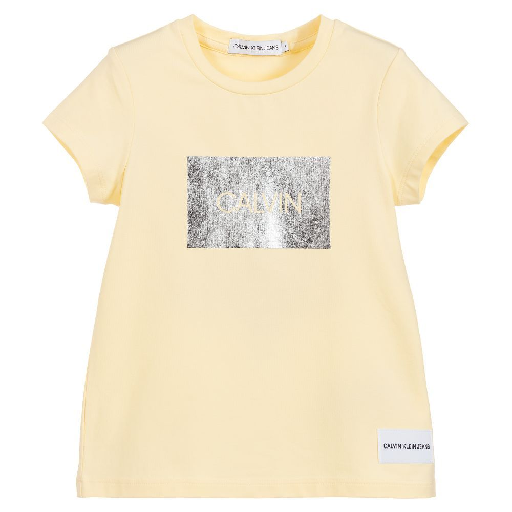 1ac3a708 Pale primrose yellow T-shirt for girls by American designer Calvin ...