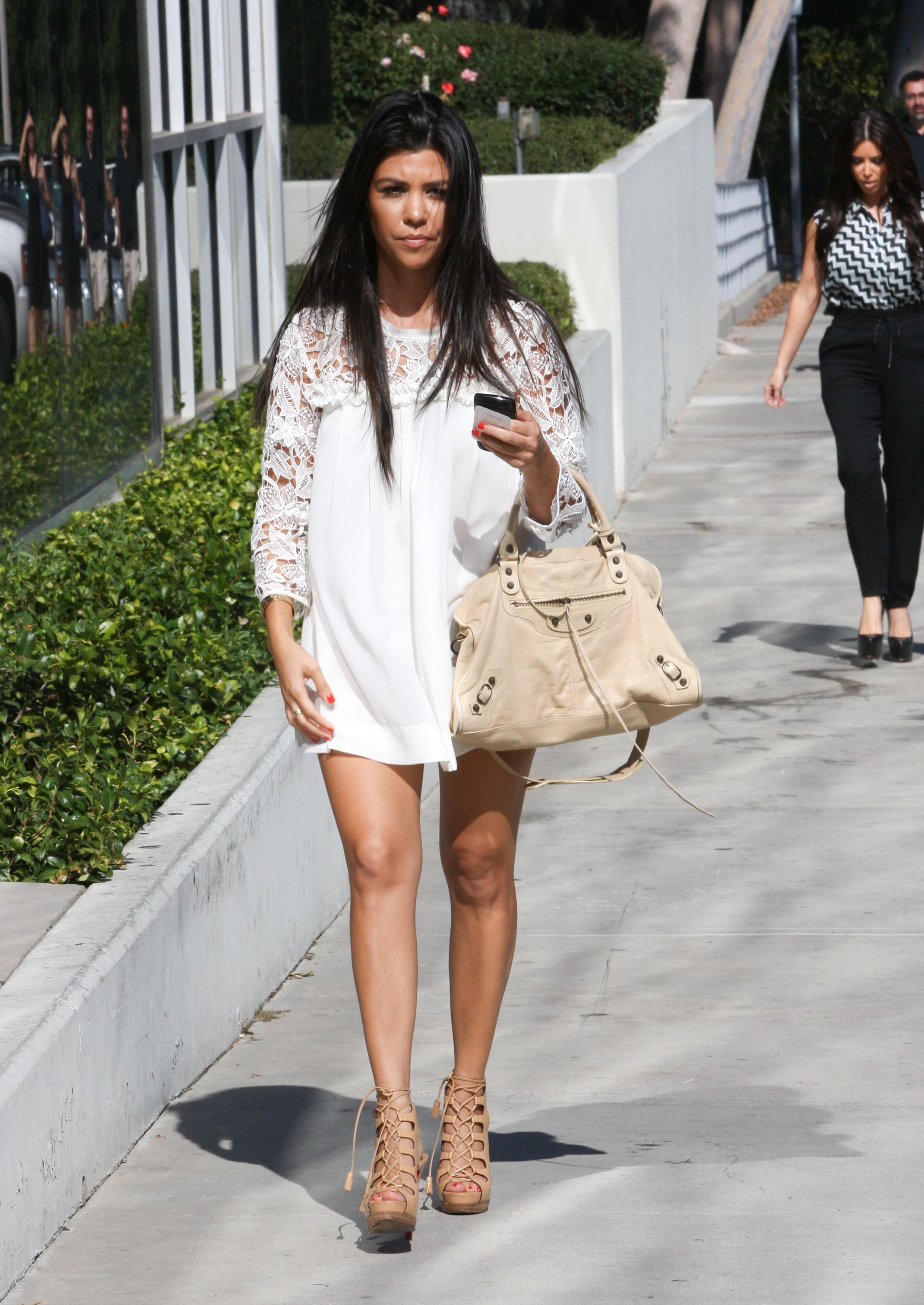 Kourtney kardashian pregnant white summer dress matching kourtney kardashian pregnant white summer dress matching balenciaga bag ombrellifo Images