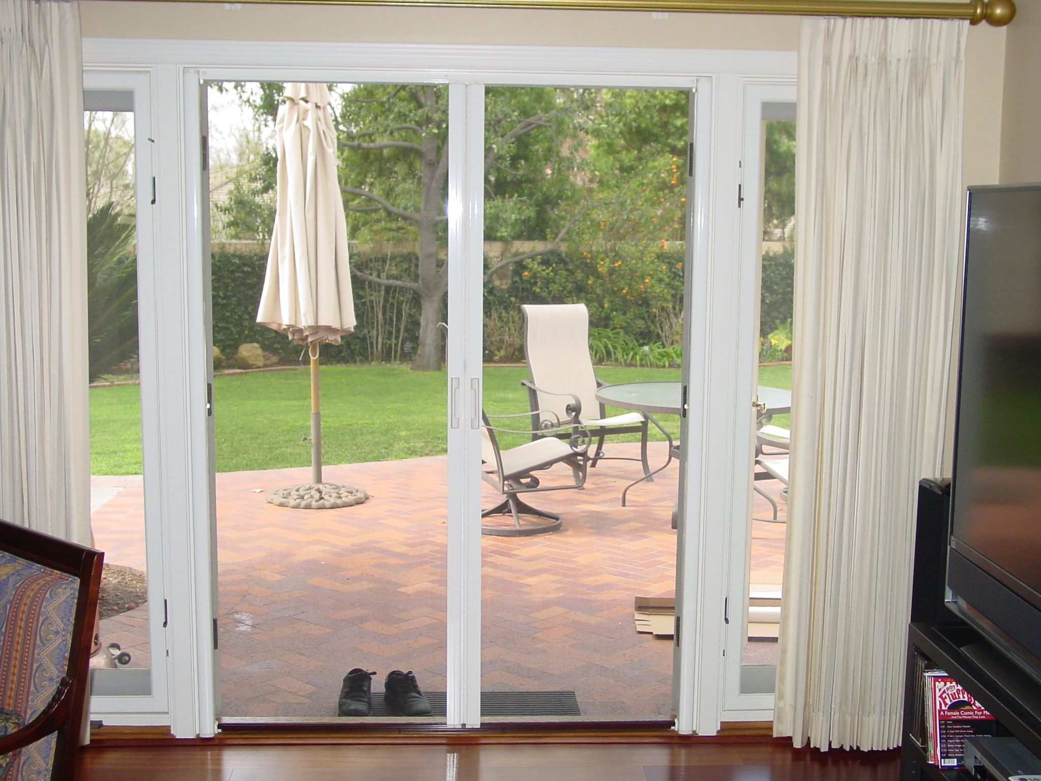Retractable Screen Door Mounted Inside Home. Doors Swing Out. Bright White.  Photo By Classic Home Improvement Products Of Anaheim Hills, California
