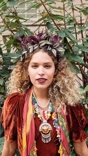 """Cleo Wade on her holiday party accessory: """"The headpiece — one of my best girlfriends makes them for her line called Wilhelm. She's a deeply spiritual, goddess-y figure, and for each headdress she makes she does a little crystal magic, or something along those lines."""" (Photo: Clement Pascal for The New York Times)"""