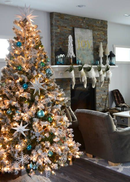 """Our Christmas tree is flocked and I decorated it with a mixture of vintage and handmade ornaments."" -Christina Dennis of The DIY Mommy"