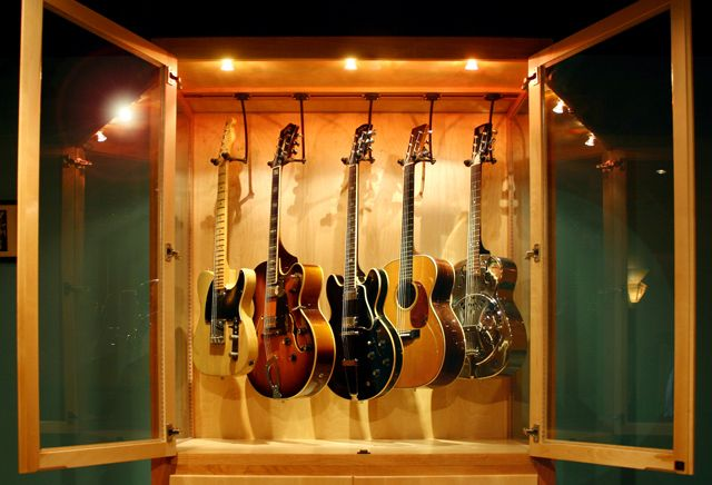 Hand Crafted Solid Wood Guitar Display Case With Humidity Control Uhmm Love Can All Those Guitars Come With Guitar Display Case Guitar Display Display Case