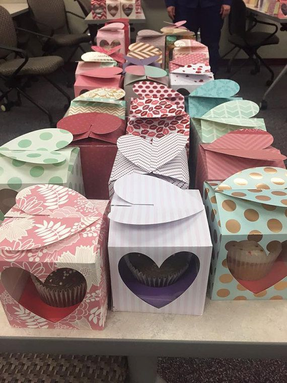 Handmade cupcake boxes with heart shaped windows and closure. Color and box design varies. Priced per size and quantity. If you need a